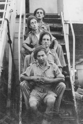 Abba Kovner, disguised as a Jewish Brigade soldier, poses with three others.jpg